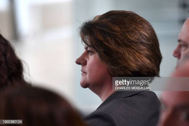 Democratic Unionist Party leader Arlene Foster listens as Britain's Prime Minister Theresa May delivers a keynote speech on Brexit at Waterfront Hall...