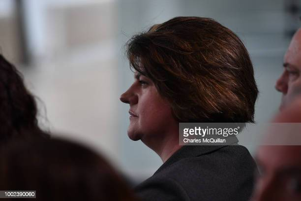 Democratic Unionist Party leader Arlene Foster watches as British Prime Minister Theresa May delivers a keynote speech at the Waterfront Hall on July...