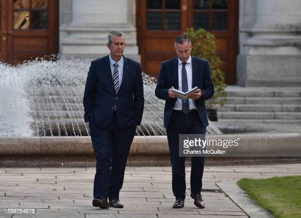 Democratic Unionist party leader Edwin Poots and potential NI First Minister Paul Givan talk with one another outside government buildings following...