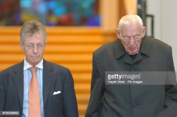 Democratic Unionist party leader, Ian Paisley, and deputy leader Peter Robinson leaving Government buildings after a meeting with Taoiseach, Bertie...
