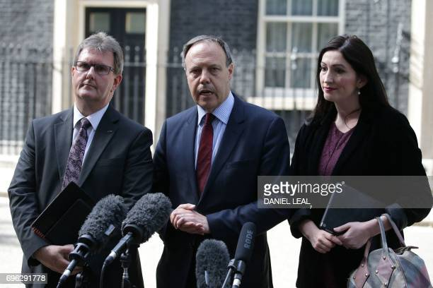 Democratic Unionist Party politicians Jeffrey Donaldson deputy leader Nigel Dodds and Emma Pengelly speak to members of the media outside 10 Downing...
