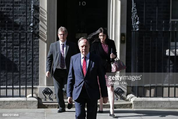 Democratic Unionist Party politicians Jeffrey Donaldson deputy leader Nigel Dodds and Emma Pengelly walk out from 10 Downing Street to speak to...