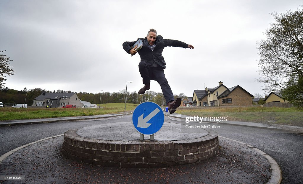 Democratic Unionist Party Westminster candidate Ian Paisley Jr jumps over a roundabout sign whilst out canvassing on April 29, 2015 in Ballymoney, Northern Ireland. Son of the late Ian Paisley, founder of the DUP and former Northern Ireland First Minister, Paisley Jr successfully ran to succeed his father as the Westminster MP for North Antrim in the 2010 UK general election, winning 46.4% of the vote share. Political observers have suggested that the DUP, with a probable 8-10 Westminster seats could have an influential role to play if the General Election results in a hung parliment. The DUP has said that they are open to working with either the Conservatives or the Labour party.