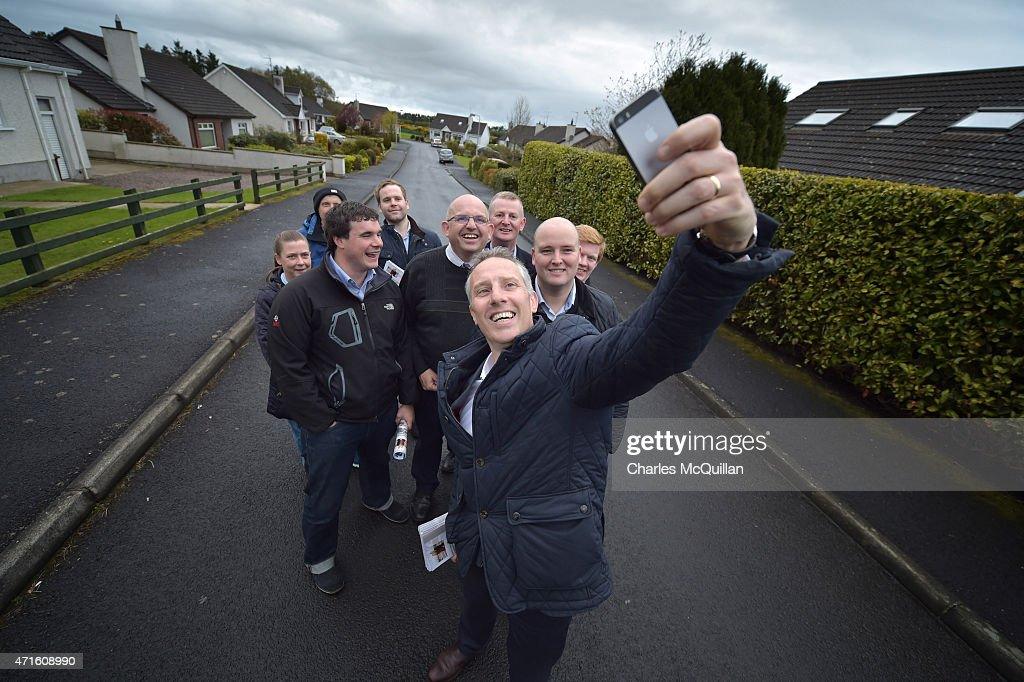 Democratic Unionist Party Westminster candidate Ian Paisley Jr takes a 'selfie' with his election team whilst out canvassing on April 29, 2015 in Ballymoney, Northern Ireland. Son of the late Ian Paisley, founder of the DUP and former Northern Ireland First Minister, Paisley Jr successfully ran to succeed his father as the Westminster MP for North Antrim in the 2010 UK general election, winning 46.4% of the vote share. Political observers have suggested that the DUP, with a probable 8-10 Westminster seats could have an influential role to play if the General Election results in a hung parliment. The DUP has said that they are open to working with either the Conservatives or the Labour party.
