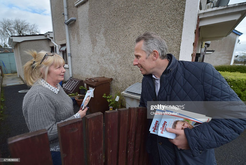 Democratic Unionist Party Westminster candidate Ian Paisley Jr talks to a potential voter whilst out canvassing on April 29, 2015 in Ballymoney, Northern Ireland. Son of the late Ian Paisley, founder of the DUP and former Northern Ireland First Minister, Paisley Jr successfully ran to succeed his father as the Westminster MP for North Antrim in the 2010 UK general election, winning 46.4% of the vote share. Political observers have suggested that the DUP, with a probable 8-10 Westminster seats could have an influential role to play if the General Election results in a hung parliment. The DUP has said that they are open to working with either the Conservatives or the Labour party.