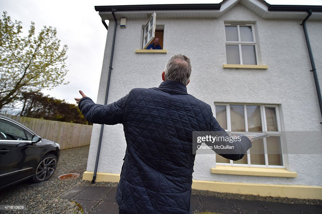 Democratic Unionist Party Westminster candidate Ian Paisley Jr appeals to a voter whilst out canvassing on April 29, 2015 in Ballymoney, Northern Ireland. Son of the late Ian Paisley, founder of the DUP and former Northern Ireland First Minister, Paisley Jr successfully ran to succeed his father as the Westminster MP for North Antrim in the 2010 UK general election, winning 46.4% of the vote share. Political observers have suggested that the DUP, with a probable 8-10 Westminster seats could have an influential role to play if the General Election results in a hung parliment. The DUP has said that they are open to working with either the Conservatives or the Labour party.