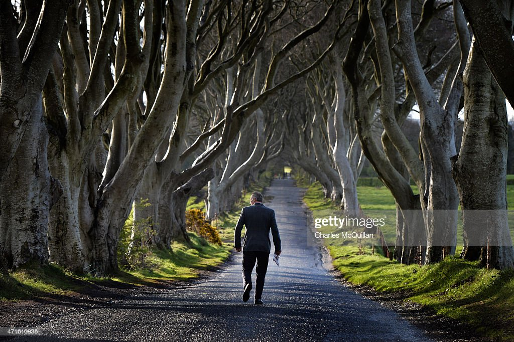 Democratic Unionist Party Westminster candidate Ian Paisley Jr walks along the Dark Hedges whilst out canvassing on April 29, 2015 in Ballymoney, Northern Ireland. Son of the late Ian Paisley, founder of the DUP and former Northern Ireland First Minister, Paisley Jr successfully ran to succeed his father as the Westminster MP for North Antrim in the 2010 UK general election, winning 46.4% of the vote share. Political observers have suggested that the DUP, with a probable 8-10 Westminster seats could have an influential role to play if the General Election results in a hung parliment. The DUP has said that they are open to working with either the Conservatives or the Labour party.