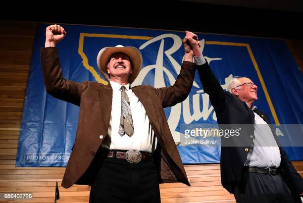 Democratic US Congressional candidate Rob Quist and US Sen Bernie Sanders greet supporters during a campaign rally on May 21 2017 in Bozeman Montana...