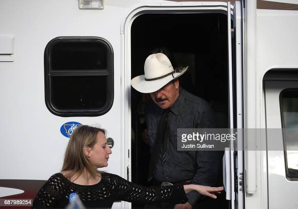 Democratic US Congressional candidate Rob Quist arrives a campaign rally at Draught Works Brewery on May 24 2017 in Missoula Montana Rob Quist is...