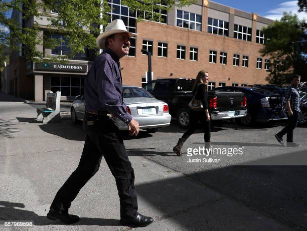 Democratic US Congressional candidate Rob Quist arrives at a campaign office to greet volunteers on May 24 2017 in Missoula Montana Rob Quist is...