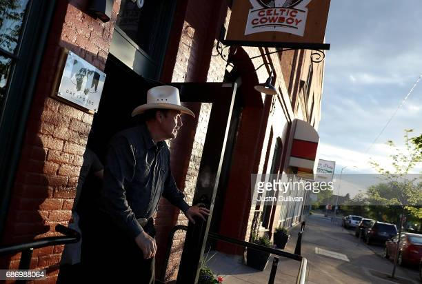 Democratic US Congressional candidate Rob Quist leaves a gathering at Darkhorse Hall and Wine Snug on May 22 2017 in Great Falls Montana Rob Quist is...