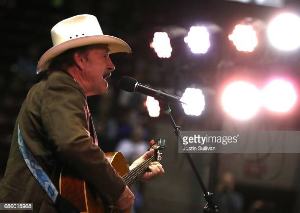 Democratic US Congressional candidate Rob Quist performs a song during a campaign rally with US Sen Bernie Sanders at the University of Montana on...