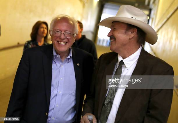 Democratic US Congressional candidate Rob Quist shares a laugh with US Sen Bernie Sanders before the start of a campaign rally at the University of...