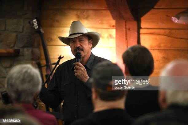 Democratic US Congressional candidate Rob Quist speaks to supporters during a gathering at Darkhorse Hall and Wine Snug on May 22 2017 in Great Falls...