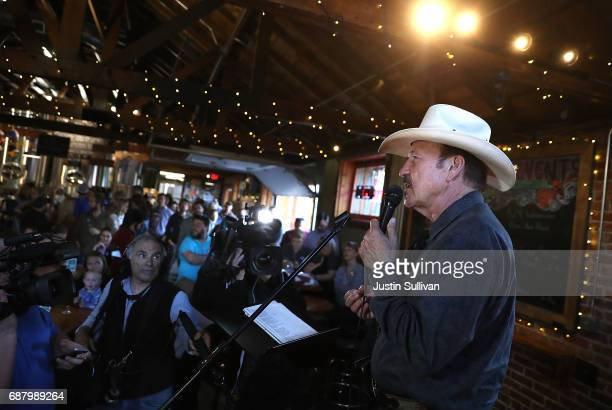 Democratic US Congressional candidate Rob Quist speaks to supporters during a campaign rally at Draught Works Brewery on May 24 2017 in Missoula...