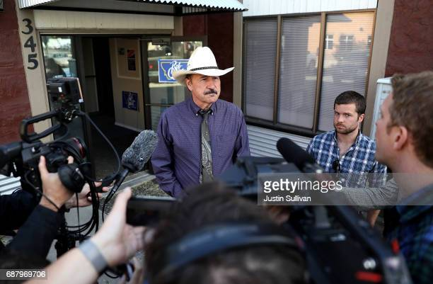 Democratic US Congressional candidate Rob Quist talks with reporters after greeting get out the vote volunteers on May 24 2017 in Missoula Montana...