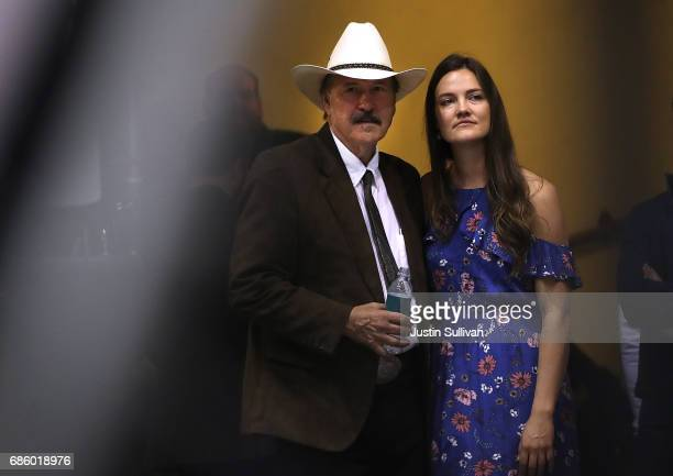 Democratic US Congressional candidate Rob Quist waits backstage with his daughter Halladay Quist during a campaign rally with US Sen Bernie Sanders...