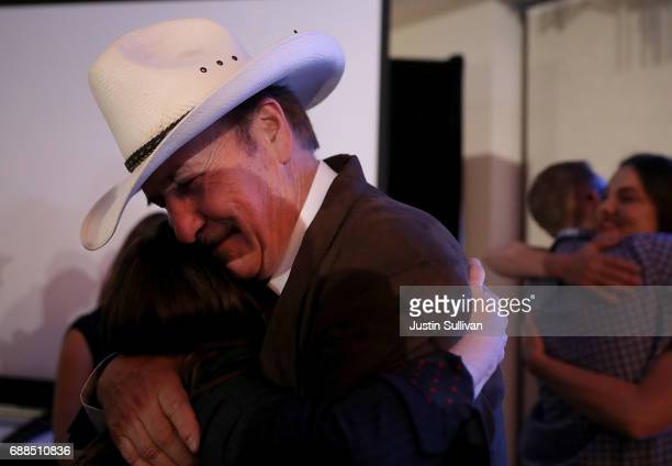 Democratic US Congresstional candidate Rob Quist hugs a supporter after delivering his concession speech at the DoubleTree by Hilton Hotel...