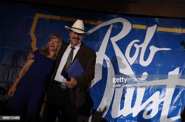 Democratic US Congresstional candidate Rob Quist hugs his wife Bonni Quist before delivering his concession speech to supporters at the DoubleTree by...