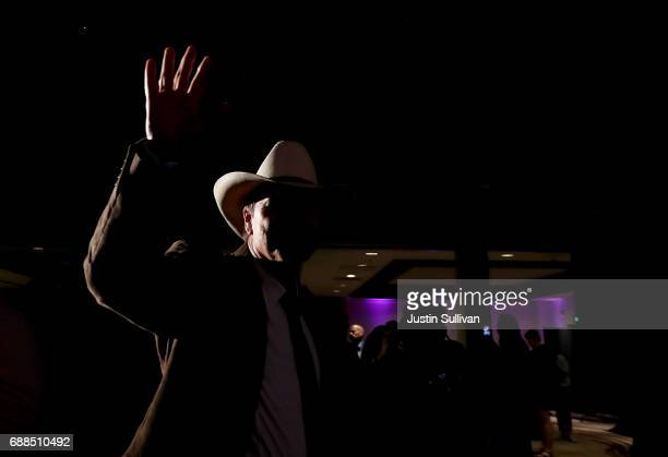 Democratic US Congresstional candidate Rob Quist waves to supporters before delivering his concession speech to supporters at the DoubleTree by...