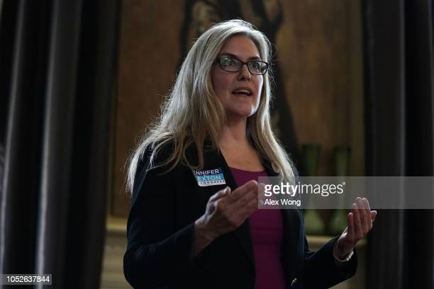 Democratic US House candidate and Virginia State Sen Jennifer Wexton speaks to constituents during a 'Meet and Greet' at a private residence October...