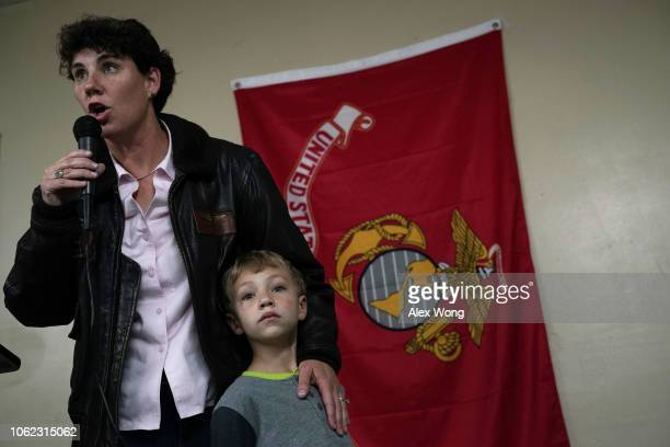 Democratic US House of Representatives candidate for Kentucky Amy McGrath speaks to supporters as her sixyearold son Teddy Henderson listens during a...