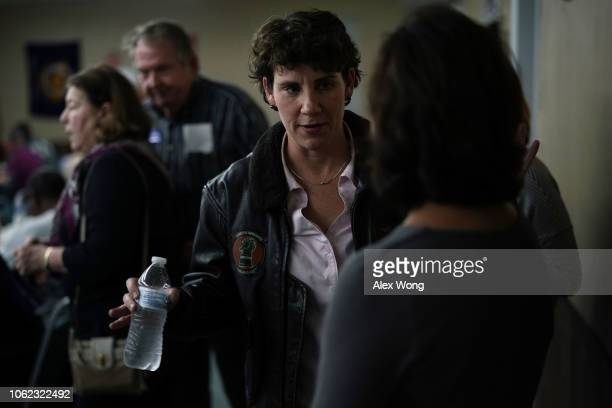Democratic US House of Representatives candidate for Kentucky Amy McGrath talks to a supporter during a community potluck dinner November 1 2018 in...