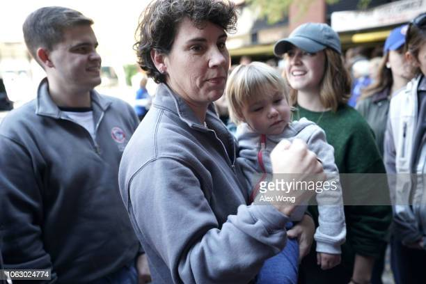 Democratic US House of Representatives candidate for Kentucky's Sixth Congressional District Amy McGrath greets supporters with her daughter Eleanor...