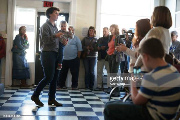 Democratic US House of Representatives candidate for Kentucky's Sixth Congressional District Amy McGrath speaks to campaign volunteers with her...