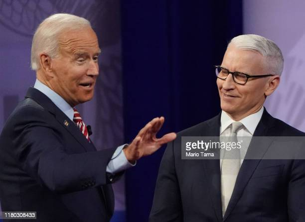 Democratic US presidential candidate and former Vice President Joe Biden gestures with CNN moderator Anderson Cooper at the Human Rights Campaign...
