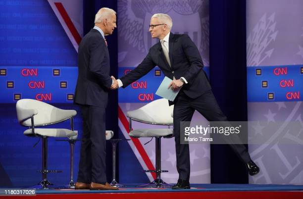 Democratic US presidential candidate and former Vice President Joe Biden shakes hands with CNN moderator Anderson Cooper at the Human Rights Campaign...