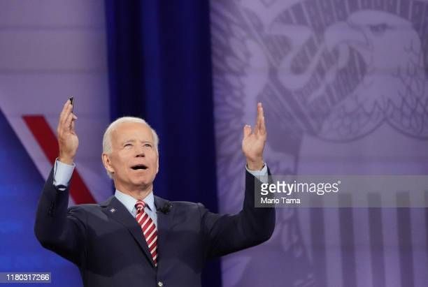 Democratic US presidential candidate and former Vice President Joe Biden gestures to the crowd at the Human Rights Campaign Foundation and CNN's...