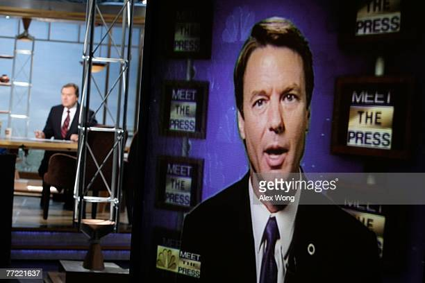 Democratic US presidential hopeful and former Sen John Edwards is seen on a TV monitor during a remote interview by moderator Tim Russert on Meet the...