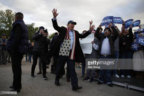 Democratic U.S. Presidential hopeful Andrew Yang arrives at a campaign rally at the Lincoln Memorial April 15, 2019 in Washington, DC. One of Yang's...