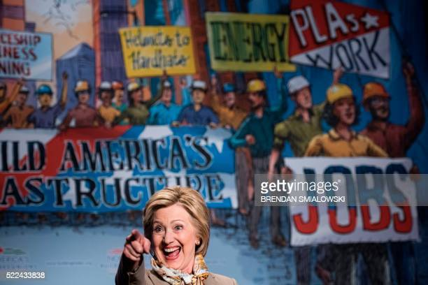 TOPSHOT Democratic US Presidential hopeful Hillary Clinton reacts while addressing the North American Building Trades Union National Legislative...
