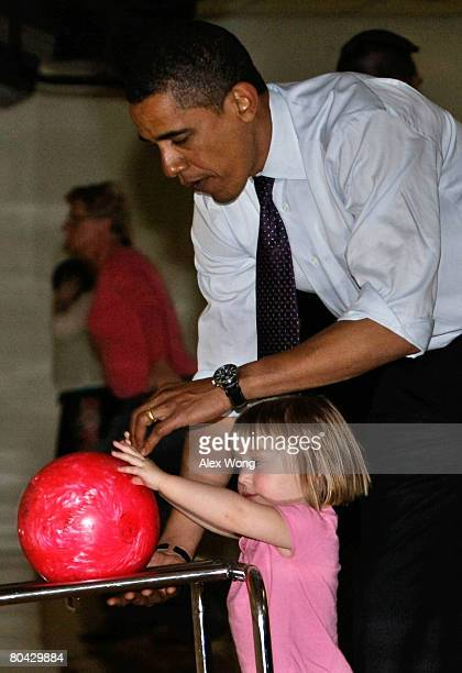 Democratic US presidential hopeful Sen Barack Obama bowls with twoyearold local resident Angelina Rhoades at Pleasant Valley Bowling Center March 29...