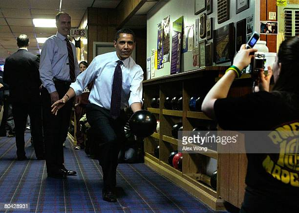 Democratic US presidential hopeful Sen Barack Obama tries out a bowling ball as US Sen Bob Casey looks on at Pleasant Valley Bowling Center March 29...