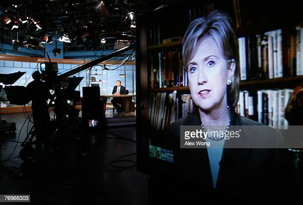 Democratic US presidential hopeful Sen Hillary Rodham Clinton is seen on a TV monitor during a remote interview by moderator Tim Russert on 'Meet the...