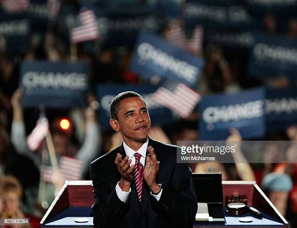 Democratic US Presidential nominee Sen Barack Obama reacts to the crowd on day four of the Democratic National Convention at Invesco Field at Mile...