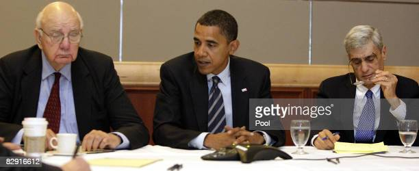Democratic US Presidential nominee Sen Barack Obama speaks with economic advisor and former Chairman of the Federal Reserve Paul Volcker and Director...