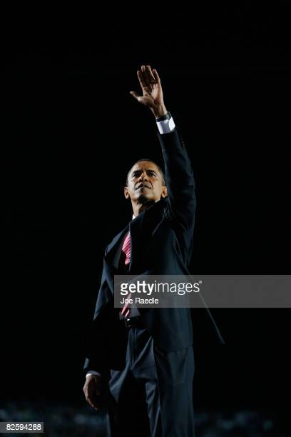 Democratic US Presidential nominee Sen Barack Obama waves to the crowd after his speech on day four of the Democratic National Convention at Invesco...