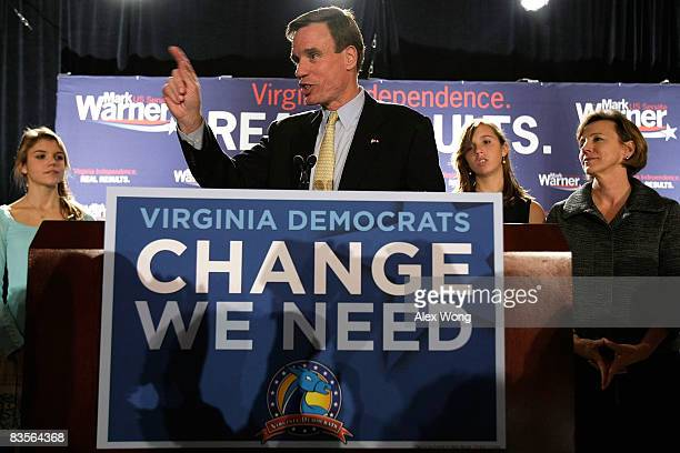 Democratic US Senate candidate and former Virginia Gov Mark Warner speaks as his daughters Madison Eliza and wife Lisa Collis look on during a...