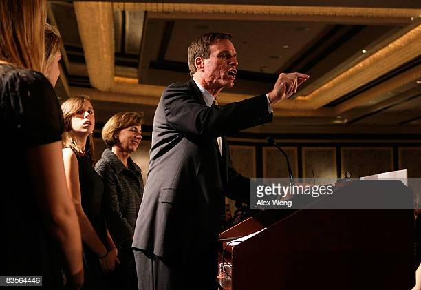 Democratic US Senate candidate and former Virginia Gov Mark Warner speaks as his daughter Eliza and wife Lisa Collis look on during a election night...