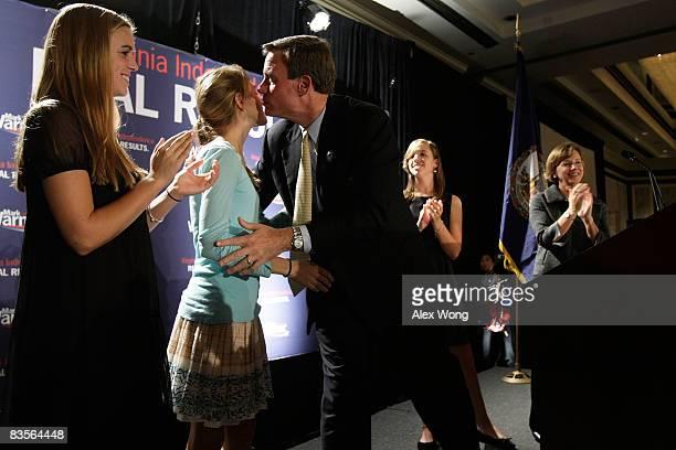 Democratic US Senate candidate and former Virginia Gov Mark Warner kisses his daughter Madison as his daughters Gillian Eliza and wife Lisa Collis...
