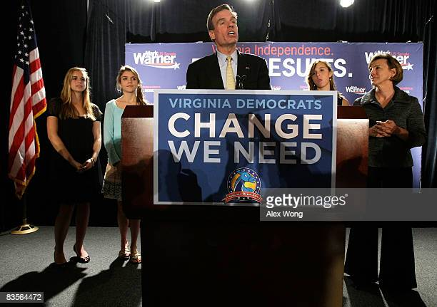 Democratic US Senate candidate and former Virginia Gov Mark Warner speaks as his daughters Gillian Madison Eliza and wife Lisa Collis look on during...