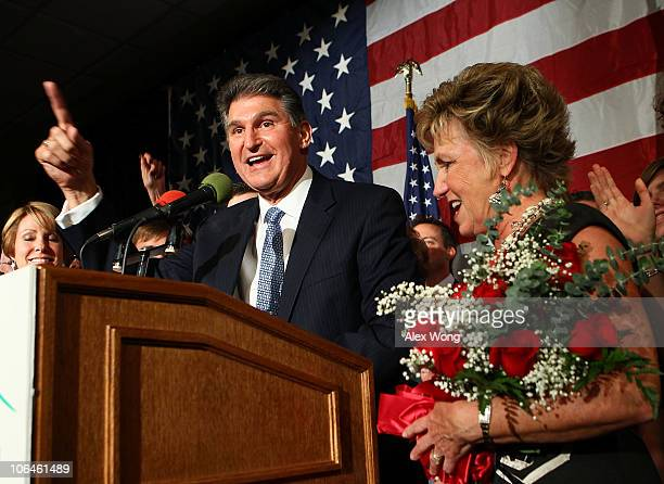 Democratic U.S. Senate candidate and West Virginia Governor Joe Manchin celebrates as his wife Gayle looks on during a election night victory party...