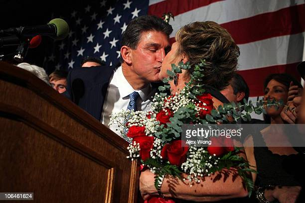 Democratic U.S. Senate candidate and West Virginia Governor Joe Manchin celebrates as he kisses his wife Gayle during a election night victory party...