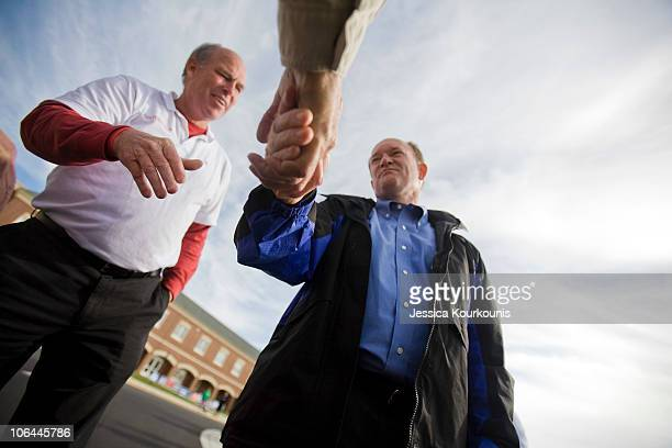 Democratic US Senate Candidate Chris Coons and State Representative Pete Schwartzkopf greet voters outside of the polls at Cape Henlopen High School...