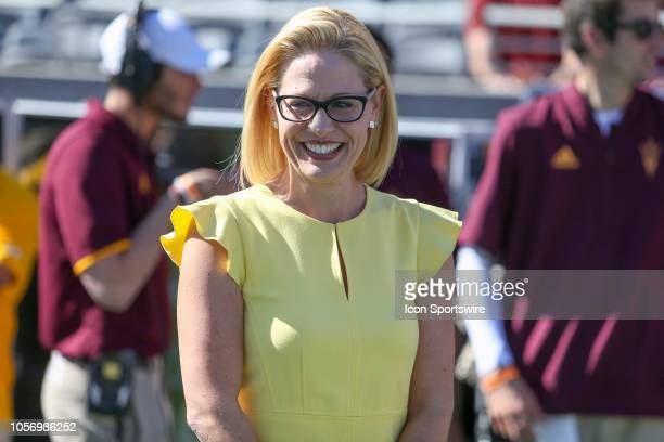 Democratic US Senate candidate Kyrsten Sinema smiles before a college football game between the Arizona State Sun Devils and the Utah Utes on...