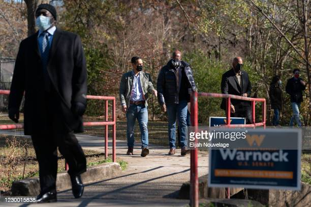 Democratic U.S. Senate candidate Raphael Warnock arrives at a campaign event with former Democratic presidential candidate Julián Castro on December...